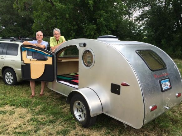 Teardrop camper with a queen bed and a kitchen